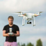Person Flying a Camera Drone Stock Images