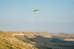 Paraplane. Person flying on paraplane, beautiful sky on background Royalty Free Stock Photo