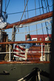 Person Folding Flag on Ship. Person folding a flag on board a ship stock image