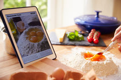 Person Following Pasta Recipe Using App On Digital Tablet Royalty Free Stock Photo