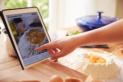 Person Following Pasta Recipe Using App On Digital Tablet Stock Images
