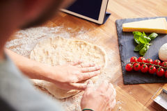 Person Following Pizza Recipe Using App On Digital Tablet Royalty Free Stock Photography