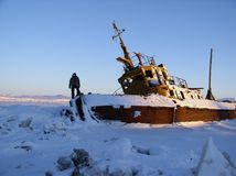 The person on the frozen vessel. The north of Russia, 2006 Stock Photography