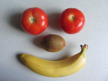 A person from fruits and vegetables. On the table Stock Image