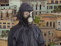 Person in gas mask against the backdrop of abandoned production Royalty Free Stock Image
