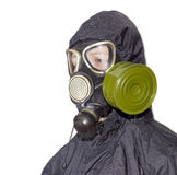 Person in a gas mask on a light background. Head and shoulders of a person in a rubber gas mask with filter mounted on side of the mask and drinking tube and in Stock Photos