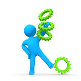 Person Gearing Up. A person catching gears or cogwheels Stock Photo