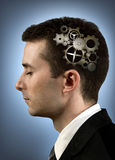 Person with gears in his head Royalty Free Stock Image