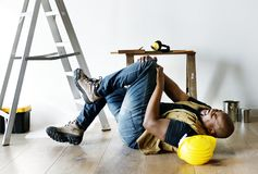 A person getting injured falling from a ladder Stock Photo