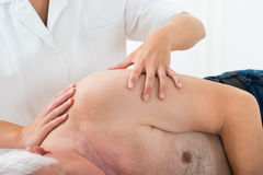 Person Getting Massage From Masseuse. Close-up Of A Person Getting Massage From Masseuse In Spa Stock Photos