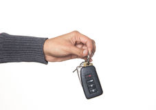 Person giving a car key. Person handing over a car key Royalty Free Stock Images