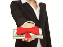 Person Giving a Generous Bonus. Businessperson giving generous bonus as a corporate gift stock photos