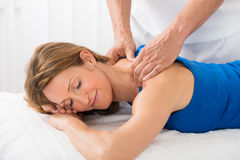 Person Giving Massage To Woman Stock Images