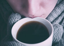 Person With Gloves Holding Coffee Mug Stock Photo