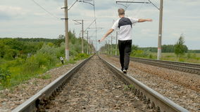 A person goes by rail. Summer sunny day. slow motion stock video