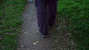 Person going on path. At the evening stock footage