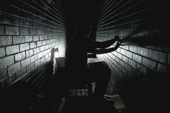 Person in Between Grey Bricks Wall Trying to Attach Bricks With Single Led Light Stock Photos