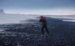Person in Grey Jacket and Blue Denim Jeans Tacking a Photo in a Snowy Field during Daytime Royalty Free Stock Image