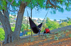 Person in hammock overlooking Laguna Beach and Pacific Ocean, California. Photo shows a person resting in a well placed hammock overlooking Laguna Beach and royalty free stock image