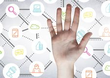Person hand against digitally generated connecting icons. Close-up of person hand against digitally generated connecting icons Stock Photo