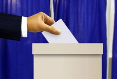 Person hand casting a vote Stock Images
