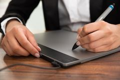 Person hand drawing on graphic tablet Stock Photography