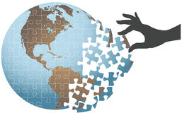 Person hand find global puzzle solution. Woman hand puts puzzle together to find global solution Royalty Free Stock Image
