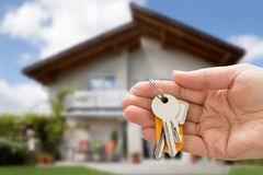 Person hand holding house key Royalty Free Stock Image