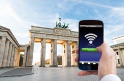 Person hand with mobile phone at brandenburg gate Royalty Free Stock Image