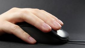 Person hand on mouse, black, side view. Person hand on mouse, on black background, side view stock video