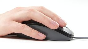 Person hand on mouse, white, side view. Person hand on mouse, on white background, side view stock video footage