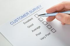 Person hand with pen over customer survey form Royalty Free Stock Photos