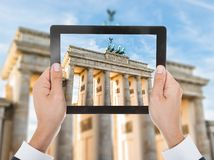 Person hand photographing brandenburg gate Royalty Free Stock Photo