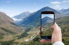 Person hand photographing landscape Stock Photos