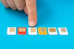 Person hand selecting sim card Stock Images