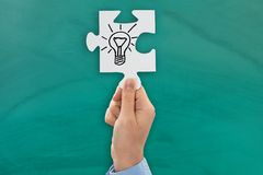 Person hand showing bulb symbol Stock Image