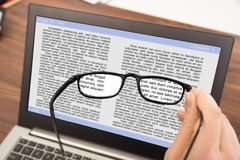 Person hand with spectacles and laptop Stock Photos