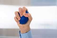 Person hand with stressball Royalty Free Stock Photography