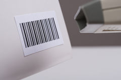 Person Hand Using A Barcode Scanner. Close-up Of Person Hands Using Barcode Scanner To Scan A Barcode On A Box Royalty Free Stock Photography