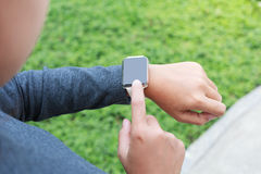 Person hand wear smart watch new modern lifestyle Stock Image