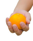 A person is handing an orange for you. Royalty Free Stock Photography