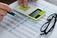 Person Hands Analyzing Accounting Document Royalty Free Stock Photography
