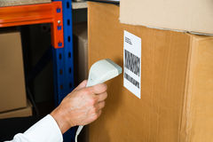 Person Hands With Barcode Scanner Scanning Box Stock Photos