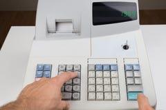 Person Hands On Cash Register Foto de archivo