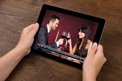 Person Hands With Digital Tablet Showing Video Royalty Free Stock Photos