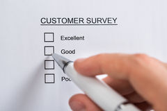 Person Hands Filling Customer Survey Form. Close-up Of Person Hands With Pen Filling Customer Survey Blank Form stock images