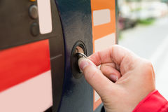 Person Hands Inserting Coin Into Parking Meter Stock Images