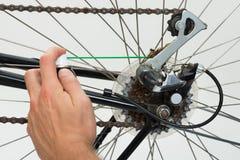 Person Hands Lubricating Bike Fotografía de archivo