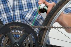 Person Hands Lubricating Bike Foto de archivo libre de regalías