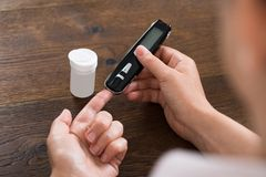Person Hands Measuring Blood Sugar Stock Images